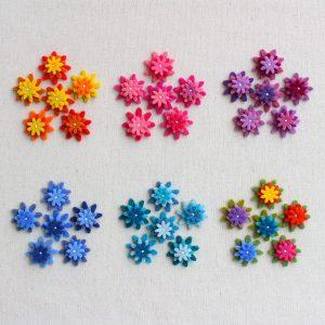 Mix fiorellini in feltro sovrapposti e cuciti - Cose di Laura creatività in feltro